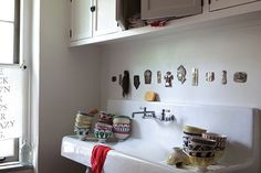 An enamel farmhouse sink with a drainboard provides space for washing and drying plus elbow room to cook. This one is in the Queens, New York, kitchen of Aesthetic Movement founders Jesse James and Kostas Anagnopoulos (the cafe-au-lait bowls are from their housewares line Sir/Madam). Source a vintage sink from a salvage dealer near you, or consider the 42-Inch Cast-Iron Wall-Hung Kitchen Sink with Drainboard, $995.95, from Signature Hardware. Tour this apartment in Calm and Collected.