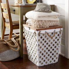 An elegant addition to your bedroom or bath, our Millie Hamper is exclusive to Pier 1 and ships fully assembled with its cotton liner included. Crafted with a patterned white iron frame and rope handles, Millie features a wooden top for versatile style in any setting.