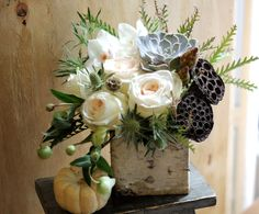 Pale roses, succulent and lotus pods in birch vase - Gotham Florist NY.