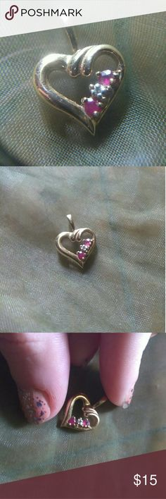 925 gold plated ruby and diamond heart pendant 925 stamped gold plated heart pendant with natural ruby and diamond stones. Great used condition. Jewelry Necklaces