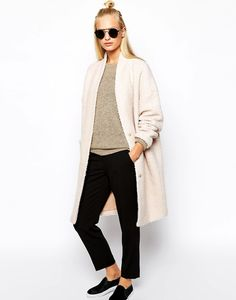 Half-Up top knot, textured coat, cropped pants & slip-on sneakers #style #fashion #hair