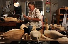 Above, Bill Walters works on one of his many decoy ducks in his woodworking shop in the basement of his house. Walters doesn't just carve the decoys;