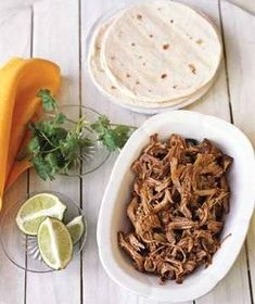 Top these pulled-pork tacos with chopped red onion, sliced jalapeños, and fresh cilantro for a spicy south-of-the-border taco dinner. Serve with Mexican rice and canned refried beans. Pulled Pork Tacos, Pulled Pork Recipes, Mexican Dishes, Mexican Food Recipes, Ethnic Recipes, Dinner Recipes, Mexican Meals, Dinner Entrees, Dinner Ideas