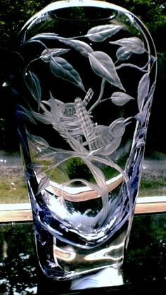 Carolina Wrens**Hand engraved Crystal by Catherine Miller of Catherine Miller Designs **Technique Stone Wheels*Vase 14 inch light lavender veil made by Stephen Fenstermacher of Yougiogheny Glass.