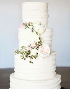 super pretty white wedding cake with little flowers