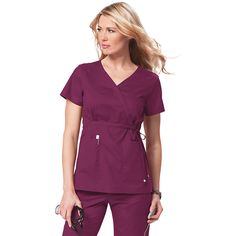 """You'll love this mock wrap scrub top from Koi Scrubs. This mock wrap top features a drawstring waist that can be adjusted for the perfect fit, side slits and two deep front patch pockets. There are rows of topstitching at the pockets, sleeve hems and hem that add sport styling. This scrub top flatters your body and makes you feel great. Center back length 25""""."""