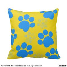 Pillow with Blue Foot Print on Yellow Background