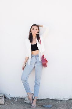 246c67734bdf US Fashion blogger Tienlyn Jacobson adds a little festivity to her  effortlessly chic look with a Folli Follie red bag   a pair of new  jewellery statement ...