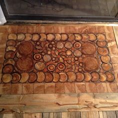 This entry way was created with end cuts of logs from our property in Colorado. The cuts are thick to match the height of the surrounding beetle kill pine flooring. Some of the cuts are aspen some are pine. The time consuming part was cutting all the tw