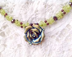 A personal favorite from my Etsy shop https://www.etsy.com/listing/227495893/peridot-and-garnet-necklace-with-molded