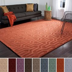 This one-of-a-kind geometric patterned wool area rug will be the perfect accessory to add that finishing touch to your decor. Whether you're looking for a splash of color or a subtle accent, this solidly colored area rug is a wonderful choice.