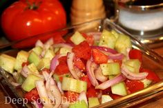 Simple Summer Cucumber, Onion and Tomato Salad - A favorite simple salad in the summer featuring garden fresh cucumbers and tomatoes, red or sweet onion and dressed in a simple vinegar and olive oil dressing.