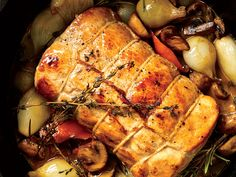 This Pork Loin Braised with Mushrooms and Wine gets its flavor from white button mushrooms, Muscat wine, and fresh orange peel. Get the recipe from Food & Wine. Pork Recipes, Wine Recipes, Cooking Recipes, How To Cook Polenta, Cooking With Beer, Fall Dinner Recipes, Fall Recipes, Holiday Recipes, Stuffed Mushrooms