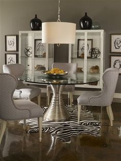 Amazing Silver Table Base with Glass Top by Vanguard.