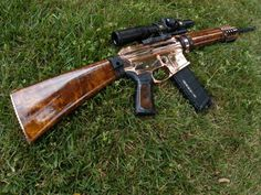 """Well known YouTuberusmcdoc14 sent us this photo of his beautiful one-of-a-kind AR-15. He wrote … The rifle shown is a combination of my love for the old brass and hardwood rifles of the past, my love for military rifles and also to cause annoyance with those who keep classifying our weapons as """"assault"""" this or …   Read More …"""