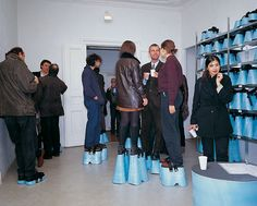 Hans Hemmert, Level, 1997, design event where each guest was given shoes to make everyone the same height (2 meters).