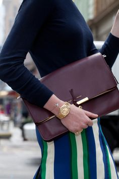 celine clutch with gold watch.