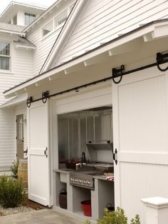 Built in Grill carriage house sliding doors. (I want this in my dream home! What a great way to keep an outdoor kitchen out of the elements! Outdoor Rooms, Outdoor Living, Outdoor Kitchens, Indoor Outdoor, Rustic Outdoor, Outdoor Grill Area, Outdoor Grilling, Outdoor Cooking, Bbq Area