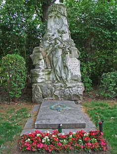 """The grave of Johann Strauss II is next to music's greatest composers: Beethoven, Schubert, and Brahms in the Zentralfriedhof, or Central Cemetery of Vienna . On the grave itself, you can see many aspects of his life: singing, dancing, and violin playing cherubs, and a bat (for """"Die Fledermaus"""", literally the """"flying bat""""). The graves of his father, brothers, and other originators of the waltz craze are nearby. He died at 74."""