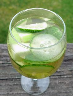Green Sangria....•1 bottle pinot grigio   •1 ½ oz Midori melon liqueur   •½ green apple, cored and sliced   •½ lime, sliced   •¼ English cucumber, sliced   •10 mint leaves   •½ kiwi fruit, peeled and sliced   •Club soda to taste. I'd leave the mint out.
