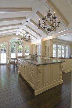 Gorgeous vaulted, beamed ceiling and a large Palladian window over glass French doors, make this kitchen incredibly light and bright.  (via Traditional Elegance - traditional - kitchen - san francisco - by Canyon Construction)