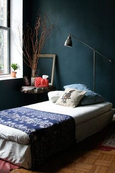 Love the saturated dark color (particularly that shade of blue) for a small room