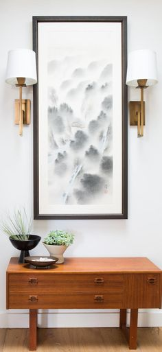 An amazing Japanese scroll that was framed from a trip to Japan, it helps create some warm lighting to the entry way. ------------------------- #picture #frames #custom #framing #gallery #wall #home #decor #diy