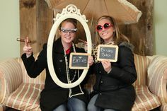 chalk board signs and an antique frame make an instant photobooth