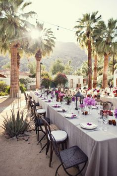 Delicate purple details beneath palm trees for the ultimate DIY wedding, anniversary or birthday party