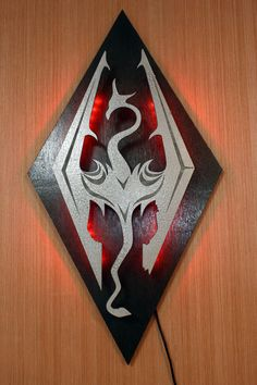 Milo would love this Skyrim light! https://www.etsy.com/listing/128056568/new-low-price-skyrim-imperial-symbol