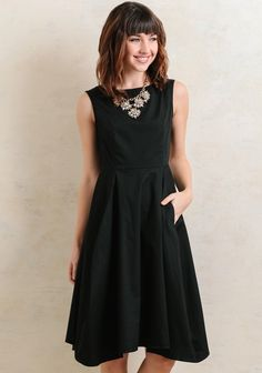 Create a classic and chic ensemble with this knee-length black dress featuring a fit-and-flare silhouette. Complete with a boat neckline and pockets at the side for casual touch, it's finis...