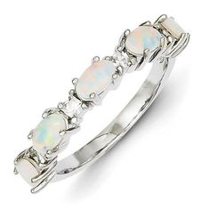- Width: 1/8 Inch (4.00mm) - Metal Type: Sterling Silver - Gemstone Type: Created Opal - Attribute 1: CZ - Attribute 2: Open Back Cubic Zirconia (CZ): Stone Creation Method:Synthetic Stone Treatment:S