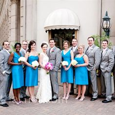 Blue Bridesmaid Dresses   The four bridesmaids chose their favorite neckline for their capri-blue, silk dupioni dresses. They groomsmen wore gray suits with pale pink ties and pocket squares.