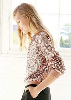 Dress up any look with this sequin sweater.