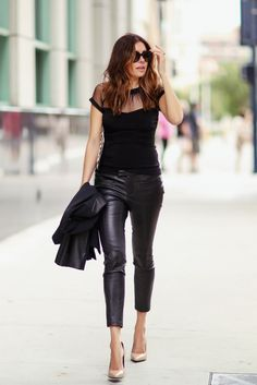 sheer feminine top with leather trousers