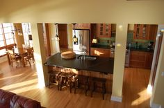 I love the functionality of this kitchen.  Soapstone, appliances and clean design and sink in island.