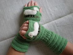 Hand-knitted green wrist warmers with hand needlecrafted sheep