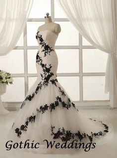 Black and White wedding gown, found on Gothic Weddings