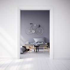 Minimal interior with bike on the wall