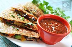 Amazing Veggie Quesadillas packed with peppers, black beans, mushrooms, spinach, and pepperjack.