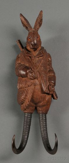 SCIENCE, TECHNOLOGY & CLOCKS - SALE 2600M - LOT 212A - BLACK FOREST MUSICAL BUGGY WHIP HOLDER, GERMANY, C. 1870, IN THE FORM OF A RABBIT DRESSED FOR THE HUNT WITH GUN AND OVERCOAT, KEY-WOUND - Skinner Inc