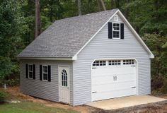 This 20x20 2-story garage was built in our shop, disassembled and reconstructed on this customer's cement slab.  Our crew has it up and ready for your car and belongings within a day.