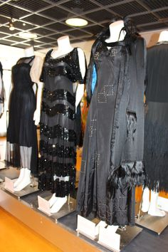 "This black dress on the far right has rhinestones and is topped with an evening coat trimmed in ""monkey fur."""