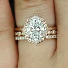"""The """"Mae"""" halo engagement ring, from Rosados Box on Etsy, showcases moissanite and diamonds and is set in 14k rose gold."""
