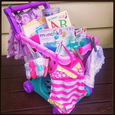 Little Girl baby shower gift or even a birthday gift. A play shopping cart, bathing suit, essentials, and books! #SuperThoughtful