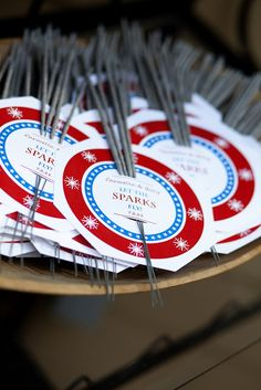 """""""Let the Sparks Fly"""" sparklers for guests at your July 4th Wedding. #July4Wedding #RedWhiteBlue #WeddingFavors"""