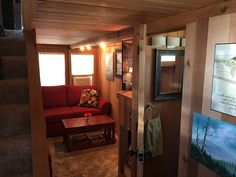"""Beautiful and spacious 3 bedroom, 1.5 bathrooms, 31.5′ x 8'6″ by 13'10"""" tall; electric fire place, 38 gallon hot water heater, full size refrigerator, dishwasher, and oven/stove ( four burner gas, currently converted to liquid propane), all-in-one washer/dryer; lots of storage!! Over 20 windows for lots of light, custom window coverings, all clear cedar interior…"""