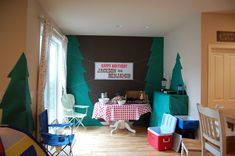 indoor camping themed troop sleepover. (pic only, no link) use camp chairs, put snacks/drinks in cooler) decorate walls with butcher paper trees, sleep in tents if there's room