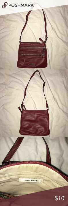 Nine West purse Gently Nine West purse. No rips, no stains. Open to offers.  It's like a burgandy color. Nine West Bags Crossbody Bags