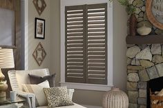 homedecor window These plantation shutters fit in beautifully with the natural, earthy tones of this living room. As an added bonus, they are easy to clean and give you several options in light control. Custom Shutters, Interior Shutters, Wood Shutters, Window Shutters, Wood Blinds, Blinds For Windows, Window Blinds, Plantation Shutters Cost, Rustic Window Treatments